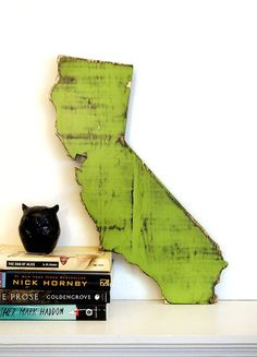 ALL STATES AVAILABLE. All of our creations are cut, sanded and painted with our own hands. A final coat of varnish finishes the piece to give it protection and durability. We love to create fun and unique pieces for your home. These make perfect gifts for anyone.    Dimensions of California State...