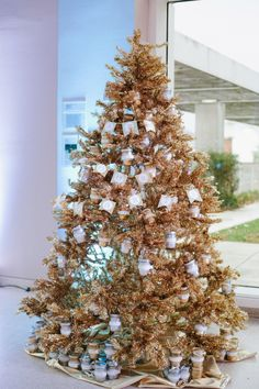 display wedding favors on a tree (Christmas or not!) // photo by Dixie Pixel