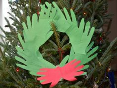 Easy paper plate wreaths - handprints, ribbons, gift bow classic childhood wreaths!