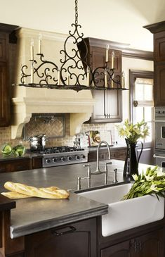 Dream kitchen- stainless steel counter tops add a fun feel to a more traditional kitchen. Also plays off the stainless steelmappliances