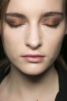 Fall 2013 makeup trend: Metallic Eye Shadows: At J. Mendel, the copper shadow was blended with a darker brown for a smoky effect.