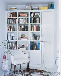 Don't forget the top of the bookcase! If there's room; use it!