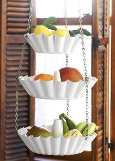 Prime some vintage or inexpensive cake tins, paint and link them together with chains and a hook. Presto! A hanging set of baskets for fruit or vegetables.