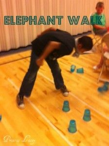 Elephant Walk Game-need pr of panty hose, baseball, 8 cups & tape. Put ball in toe of 1 leg of p hose. Make loop out of other leg. This will go around neck, make sure it's big enough to slip on easily. On ground make 2 lines w tape, tshoulder width apart & 6' long. Put cups in 2 rows inside lines. Object of game knock down all the cups w ball in p hose. Keep feet on tape & hands at sides.