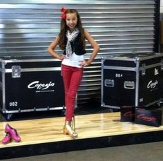 Dancer, Sophia Lucia, an official Guinness Book of World Records holder proudly showing off her custom made Capezio K360 Tap Shoes in pink and gold!