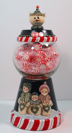 Snowman terracotta pot candy dish...no directions on how to Make this, but i think you could paint the candy cane part and  mod podge a christmas picture onto it