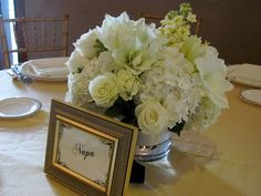 White centerpiece - white hydrangea, white roses, white stock (with white lilies instead)