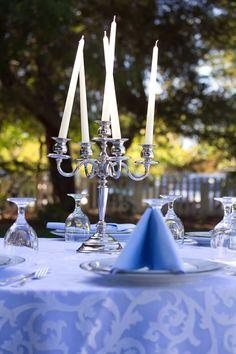 Elegant candelabras serve as wedding centerpieces. HD Video Memories & Photography.
