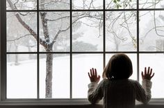 At the window watching snow fall