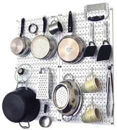 Wall Control Kitchen Pegboard Organizer Pots and Pans Pegboard Pack Storage and Organization Kit with White Pegboard and White Accessories by Wall Control, http://www.amazon.com/dp/B00CP5VN0E/ref=cm_sw_r_pi_dp_A-5Irb06ADF4D