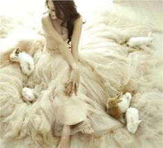 Girl in a tulle dress with bunnies all around... love it