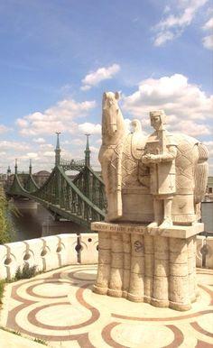 Walk across the Charles Bridge in Budapest.