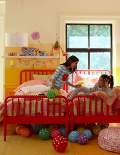 Very cute kids' room! I love the bright colors and sunlight