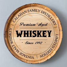 Custom signs made from the faces of actual full-sized bourbon barrels. Give each groomsman the gift of his own brand of whiskey.