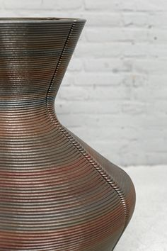 Dirk Vander Kooij uses a robotic arm to print vases from scrap plastic