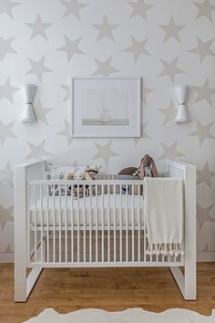 Modern Neutral & White Nursery - the statement-making star wallpaper gives this nursery an edge!
