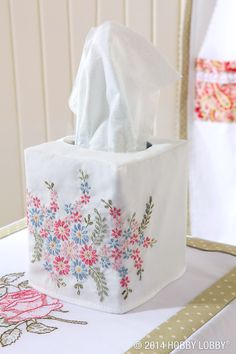 Make an easy cover for a boring tissue box. This one was made using the printed portion of a charming, pillowcase embroidery kit.