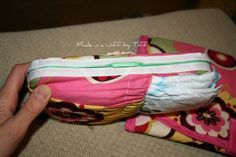 DIY Wipe and Diaper holder...  She has a ton of cute DIY projects on her site, lots of baby stuff!
