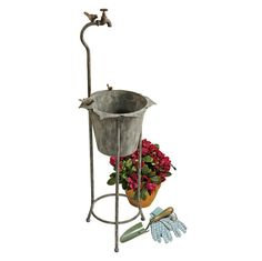 Vintage Faucet Garden Planter: Though it's all for show, the 3½ foot tall, vintage spigot is still a perfect perch for the sweet trio of garden birds that rests on this whimsical piece for home or garden.