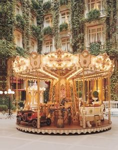 Carousel and building with well-groomed vines.  Beautiful.