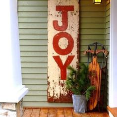 Like the idea of an oversized sign leaning against the house with JOY or PEACE