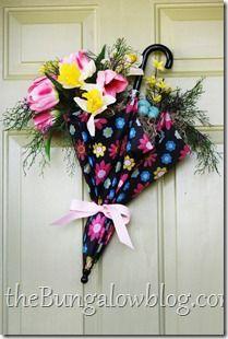 A child's umbrella decorates a door. Spring
