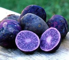 All Blue Potato -  Skin is purple and the flesh is blue  A wonderfully flavorful potato with meaty flesh that's great mashed. Skin is rich purple. Inside it's a blue that turns pale when cooked