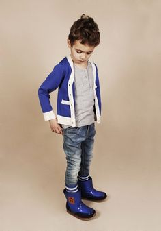 Love the cardigan, cobalt blue booties and the skinny jeans... Looks.Like.My.Boy!