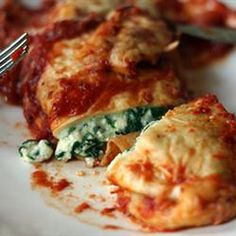 Yummy Spinach Enchiladas! These are a staple in my house. My husband loves them and he is a meat-man typically. Once/twice a week we eat meatless meals and this is definitely one of our fav's! SUPER EASY and Incredibly YUMMY! Enjoy!