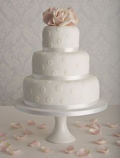 All white polka dot wedding cake with lovely pink roses on top - so beautiful #wedding #weddingcake #white #polkadot #romantic