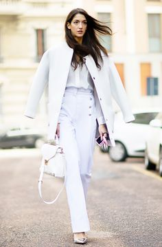 Sleek layering of all-white pieces. #streetstyle