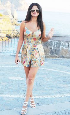 Pair a playful printed romper with neutral sandals for the perfect day to night Selena-inspired look. // #Fashion
