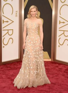 Cate Blanchett in an Armani Privé gown and opal Chopard danglers. #oscars #redcarpet