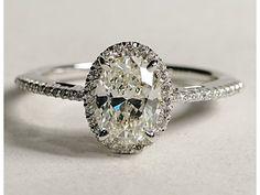 Oval halo diamond with a skinny thin diamond band