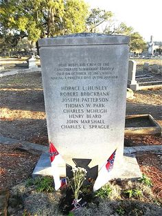 Charleston, SC~~Headstone of the graves of the second crew of the H.L. Hunley submarine including Horace L. Hunley. On October 15, 1863, though he was not part of the crew, Hunley decided to take command during a routine exercise. The vessel sank and all eight crew members were killed, including Hunley himself.