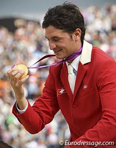 My favorite photo of the day: Switzerland's Steve Guerdat looking at his gold medal during the victory lap