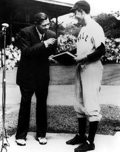 Babe Ruth donating his autobiography to the captain of Yale baseball team; future president George H.W. Bush. 1948