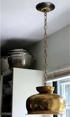 Brass pot gets lit up...great DIY repurpose light fixture. Love this and am on the hunt for one to do this with! from [Mr. Goodwill Hunting]: thrifty transformations..