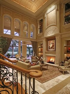 Luxury Mediterranean Living Room with some nice details - stack-back glass doors that open the house to the outside when desired, and a beautiful & unusual ceiling design...