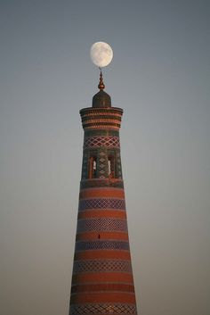 Being in the Right Place at the Right Time Moon Balancing on Minaret Khiva Uzbekistan by eriagn on Flickr.