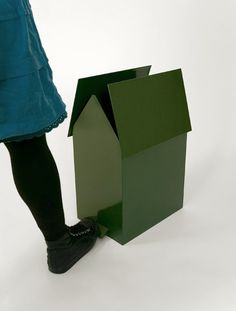 Greenhouse, by jba-design - paper bin with the shape of a house where the porch is a pedal. When you step on the porch the roof opens up. It comes in different sizes to fit different types of garbage boxes and sorting. Greenhouse is a beautiful way to store and sort your garbage. It fits both at home and in office spaces.