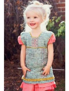 Trims and buttons add a touch of sophistication to this crochet dress pattern for girls.