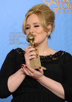 Adele was delighted with her award at the Golden Globes. Picture:Jordan Strauss/Invision/AP