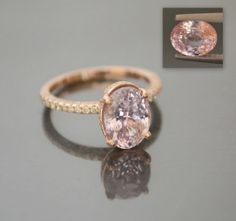 Peach Pink Sapphire and Diamond Ring**, $3100.00 this rig except a diamond instead of pink sapphire!