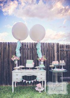 Decor at a mint + pink dessert table at a wedding. #wedding #desserttable #decor #balloons #fringe #vintage #mint #pink
