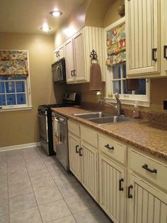 distressed white kitchen cabinets
