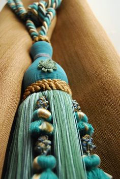 I have luxurious tassel tiebacks like this on the silk draperies in my living room- makes such a statement! From Brimar