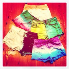 DIY shorts. Just bleach, wash and use color dye where you want let it soak then was dry and fray if you would like and their done