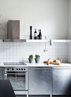 Stainless steel & tiled kitchen