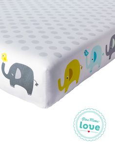 It's an elephant parade for Baby's nursery: the Circo Trunks of Love duo-print fitted crib sheet.